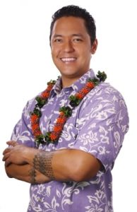 Photo of patron Kaiwi wearing a lei