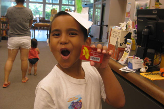 Justin holding his coveted library card.