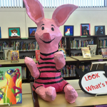 Piglet figure on library shelf