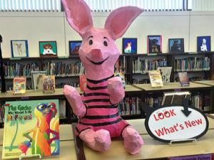 Piglet figure on library shelf