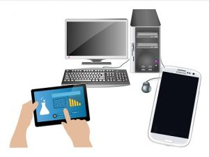A desktop computer, hand held electronic tablet, and a smart phone
