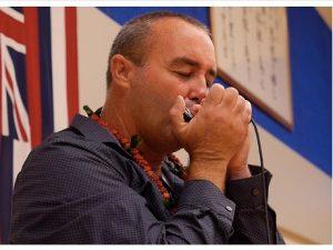 Danilo Marrone playing the harmonica.