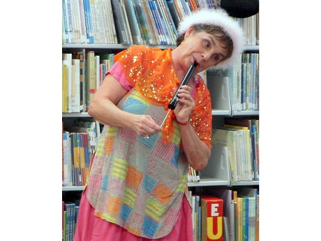 Storyteller Susie Roth using a whistle