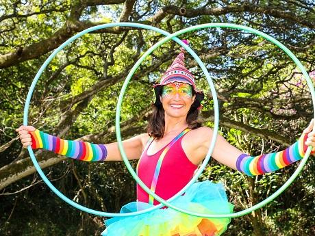 female clown holding two hula hoops