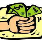 Fist holding dollar bills