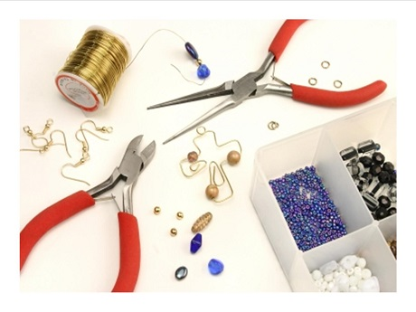 Picture of sewing thread, pliers and buttons