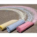 Chalk coloring a sidewalk