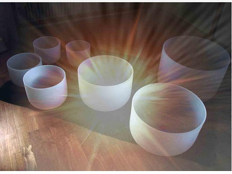 7 Crystal Singing Bowls with sun burst light shining in the center