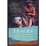 Book cover with Robyn Davidson riding one of her camels with title superimposed over the Australian outback