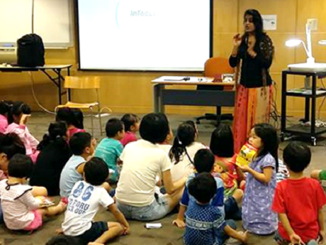 Anamika telling a story to a group of children.