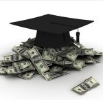 Black mortarboard atop pile of money