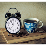 Clock with a cup of coffee