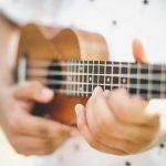 Musician Playing Ukulele Guitar