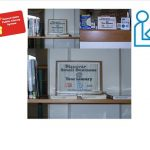 3-image photo collage of business book display at Kapolei Public Library flanked by graphics of HSPLS card and international library symbol at top