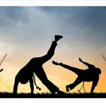 Capoeira in action at sunset