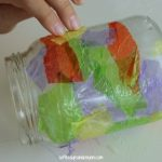 glass jar with tissue paper applied