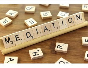 Scrabble tiles on a rack spelling out Mediation