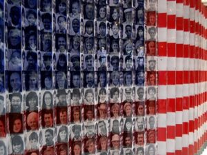Stylized American flag containing photo collage of immigrants' faces