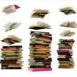 Stacks of books flying