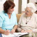 woman assisting senior making decisions