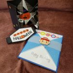 one black and orange halloween card and one blue and white card that says happy birthday