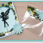 one blue green card with floral border and fairy cut out. one blue green floral favor bag