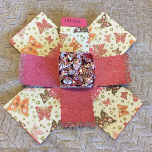 pink and cream open gift box with butterfly accents