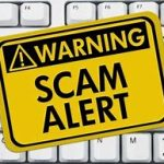 """Warning signs says """"scam alert"""""""