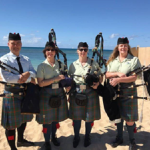 Bagpipers on beach