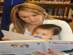 Woman reading to infant