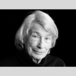 Black and white photograph of poet Mary Oliver.