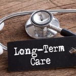 Long term care sign with stethoscope on a table