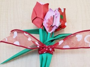 three red and pink origami tulips
