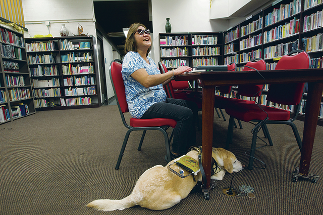 Joy with her service dog at the Library for the Blind & Physically Handicapped