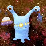 Foam alien with galaxy background
