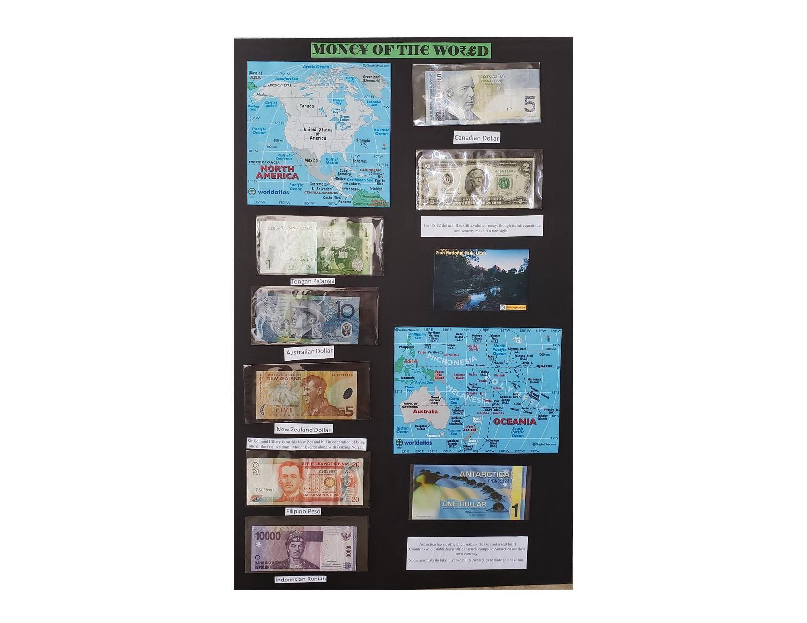"""Display board titled """"Money of the World"""" showing 8 currencies and regional maps"""