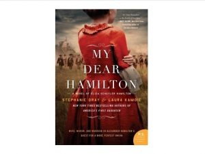 Book cover with title superimposed over the back of a woman in a red dress looking out across a battlefield