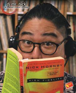 DJ Nick reading a book