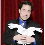 Magician James Lee holding a dove