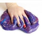 Hand squishing slime