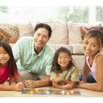 Family of four playing games