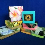eight masu boxes made of colorful flowered paper