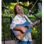 Uncle Wayne Watkins playing a guitar