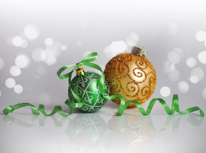 Green and gold ornaments with curly green ribbon