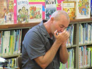 Danilo Marrone playing the harmonica