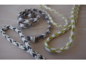 two braids of multicolored wool yarn