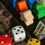 dice and meeple game pieces on board