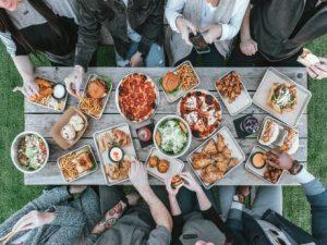 Dinner table full of food