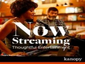 Kanopy Now Streaming picture with scene from a movie with a woman siting at a piano singing
