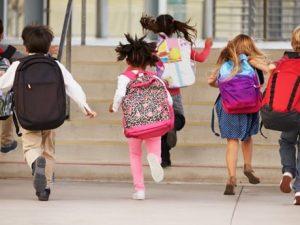 Young children running to school